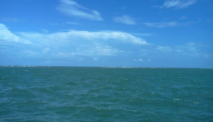 A photograph of the sparkling blue Corpus Christi bay