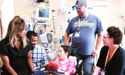 Ciara & Husband Russell Wilson Pay a Visit to Young Cancer Patient Fan