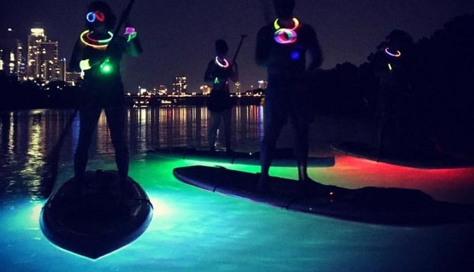 Glow-in-the-Dark Paddleboarding is the New Way to Beat the Heat