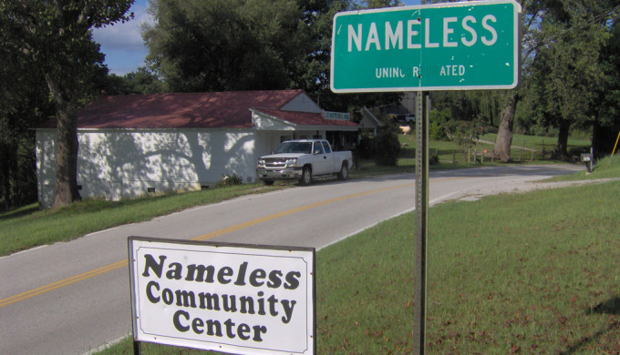 Green city sign that says Nameless
