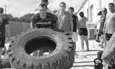 Fitness dude flipping tires.
