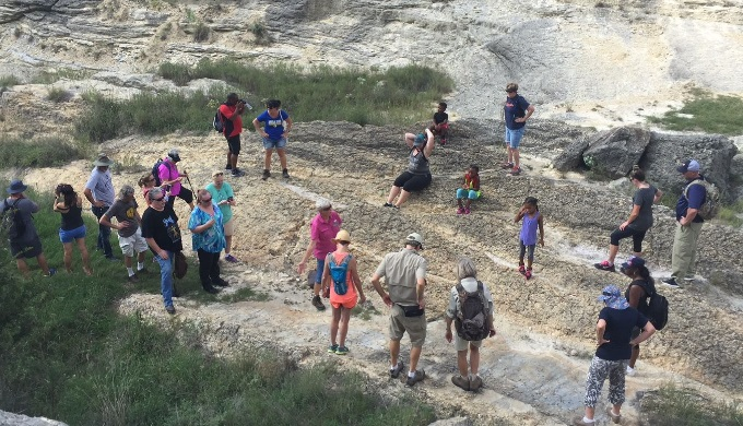 A tour group exploring the Canyon Lake Gorge