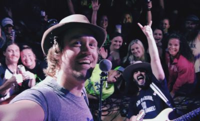 Texas Music artist Aaron Einhouse takes a selfie with him and the crowd