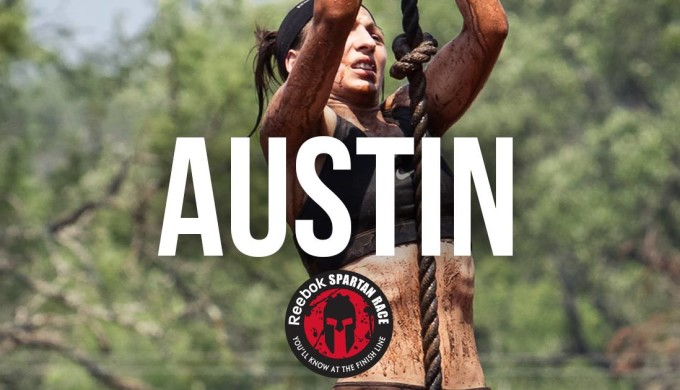 Photo of female participant climbing a rope during the Austin Spartan Race in the Hill Country