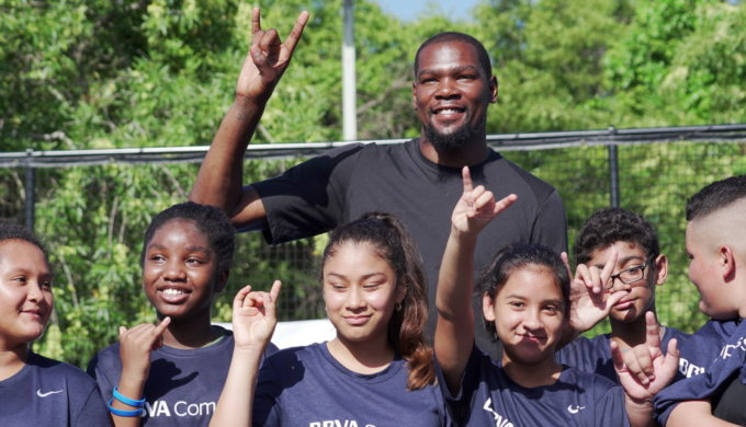 BBVA Compass Kevin Durant flashes UT sign with students during surprise visit to Austin.