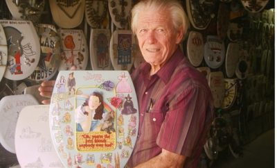 Barney Smith with one of his creations at the Toilet Seat Art Museum