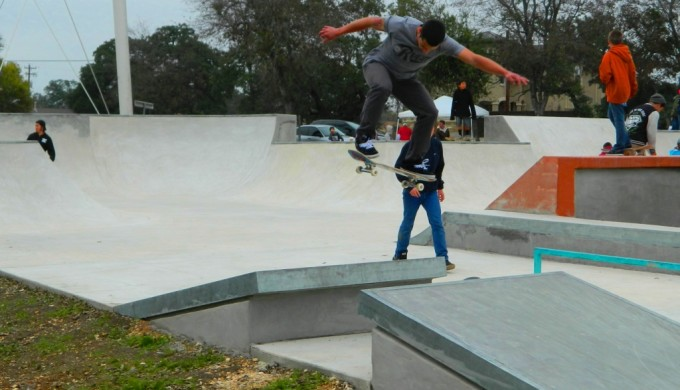 Kids skateboarding at skate park