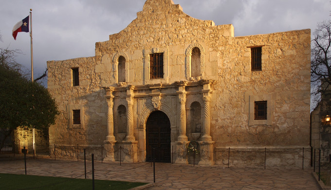 The Alamo spotlighting create a historic shrine appears. The Alamo is one the most visited historic site in America.