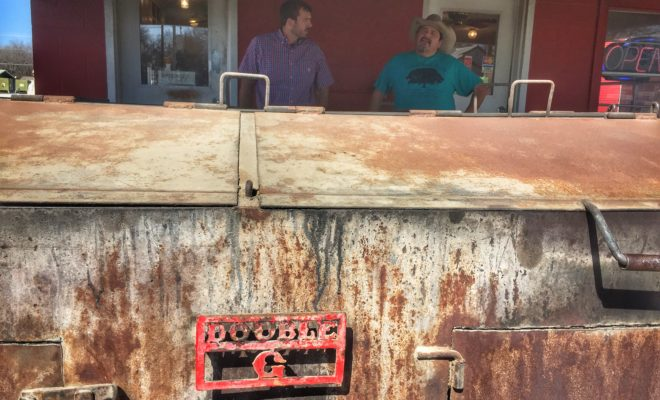 Dario Explaining BBQ at Double G Pit Stop San Saba