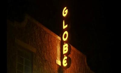 GlobeSignAtNight-resized