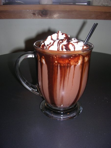 Gourmet hot chocolate with homemade whipped cream from The Loft Coffee House