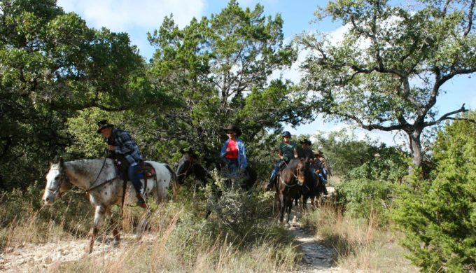 Horseback riding on equestrian trails at Hill Country State Natural Area