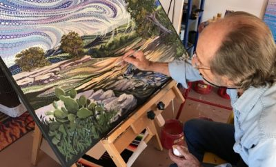 Artist Ira Kennedy Painting in his Studio
