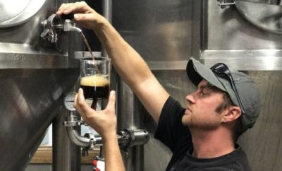 John West, an Austin brewer, samples a black lager