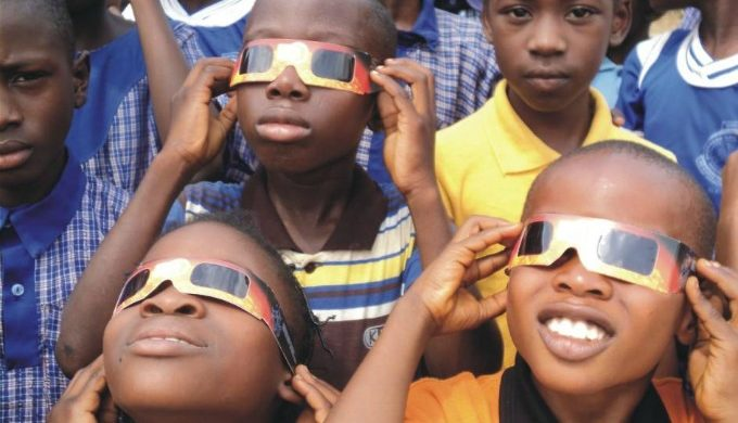 Kids with eclipse glasses