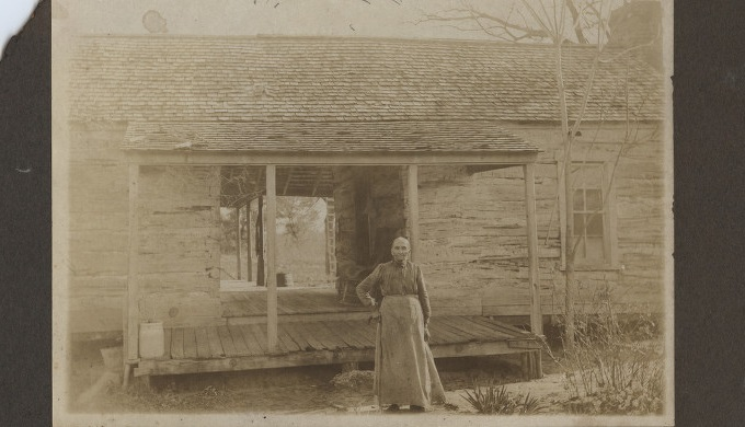 Llano County History Dog Run House 1910 with Woman Standing in Front