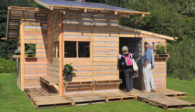This tiny house is made using only wood pallets for Pallet house plans of i beam design
