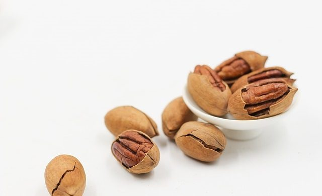 Pecans have hard inner shells that require removal to reach the nutmeat inside