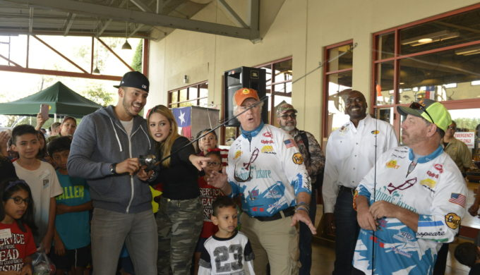 2017 World Series Champion and Houston Astros shortstop, Carlos Correa and fiancé, Daniella Rodriguez, in partnership with Vamos A Pescar, share the joy of fishing with more than 100 families by reeling in their #FirstCatch at fishing workshop in Katy,TX. (Credit: Anthony Rathbun, AP Newswire) (PRNewsfoto/Recreational Boating & Fishing)