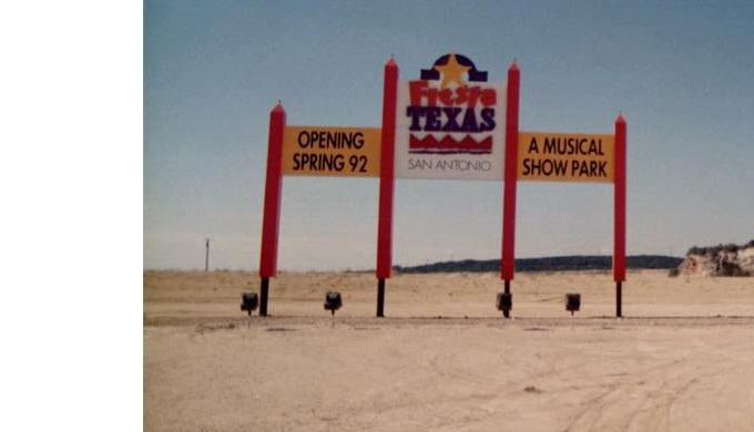 Sign advertising Six Flags Fiesta Texas's opening in 1992