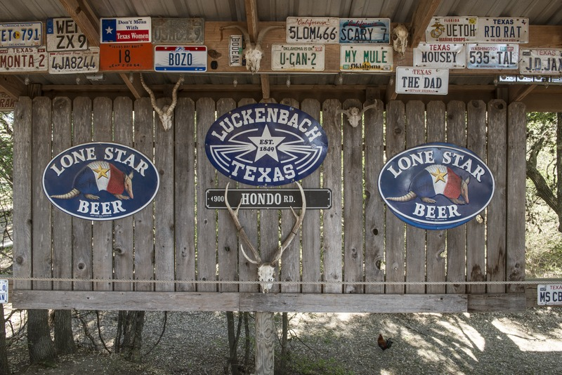 Signs_for_Luckenbach,_Texas,_a_dot_of_a_place_in_Gillespie_County,_Texas_LCCN2014633214.tif