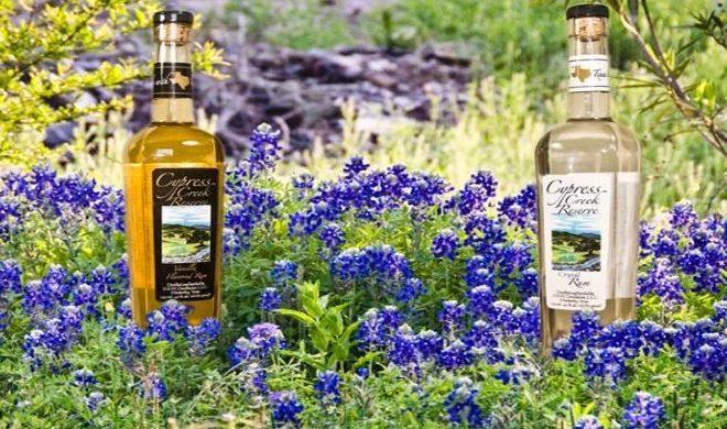 Texas Hill Country Distilleries Cypress Creek Reserve's Rum Bottle Among Bluebonnets