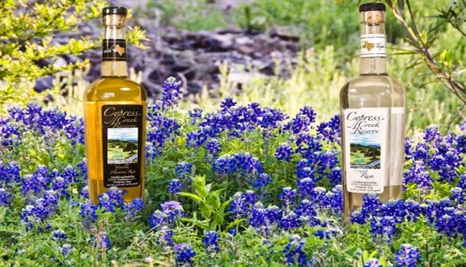 Texas Hill Country Distilleries Cypress Creek Reserve's Rum Bottle Among Bluebonnets