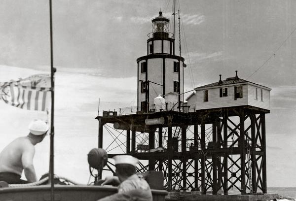 6. The need for easier cargo access to this bay called for the creation of man-made structures. Jetties were created in this busy bay to allow for the sediment to deposit further out into the bay allowing easier access to the island. Although this lighthouse toppled into the water during a storm in 2000, the lantern room can been seen at the entrance to a college on the island.
