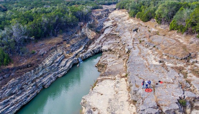 The deep gorge created by the flood showed geologists buried rock of the Hill Country
