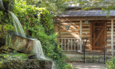Waterfall and Cabin in Courtyard of Cotton Gin Village