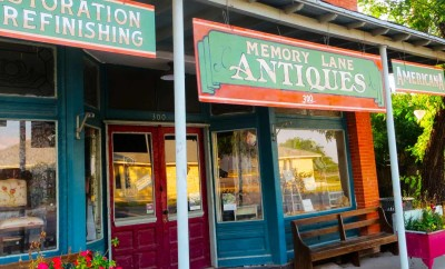 Colorful stores with antique store signs