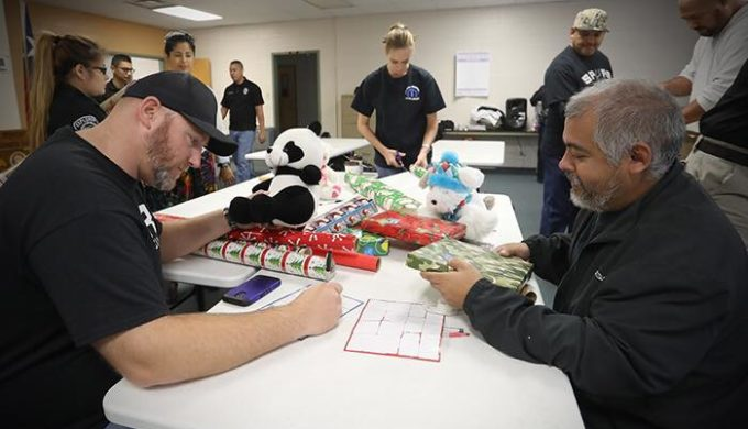 bexar county sheriff volunteers wrapping packages