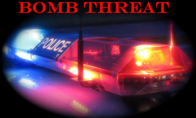 Flashing Police Light Bar with the title Bomb Threat
