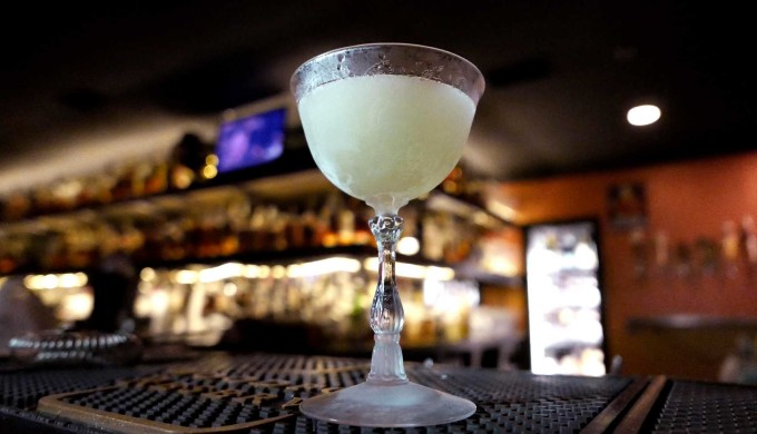 A white mule cocktail has been poured into an antique classic cocktail glass at Bar 1919 on Monday, May 25, 2015.