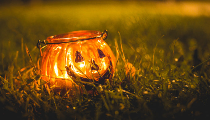 halloween-candle-holder-in-evening-grass-picjumbo-com