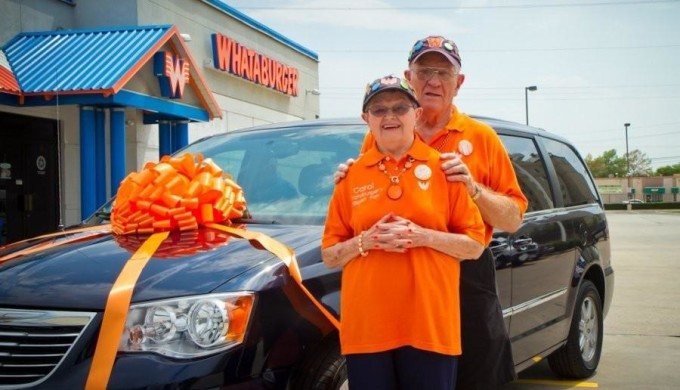 Carol and Karl Hoepfner pose in front of their new minivan, a gift from Whataburger