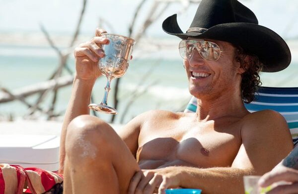 Matthew McConaughey relaxing in the sun with a beverage