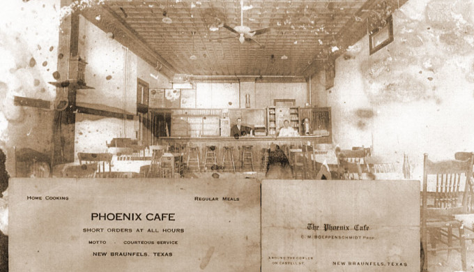 Black and white photo of interior of the Phoenix Saloon with business cards in foreground