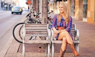 pretty woman wearing cowboy boots