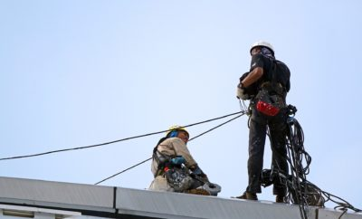 man in climbing harness rescue