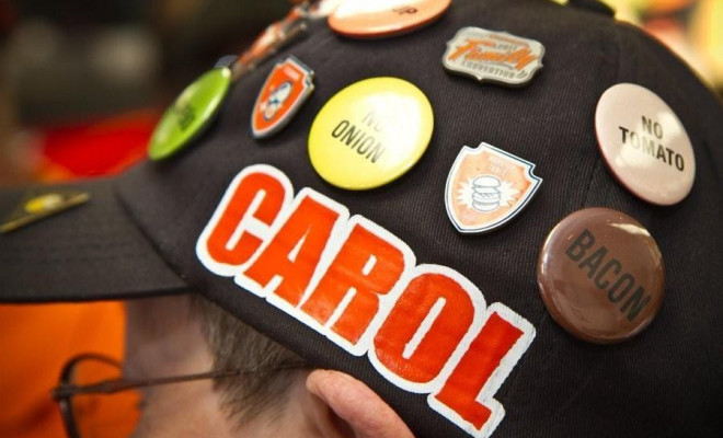 Carol Hoepfner wearing her personalized Whataburger cap with buttons